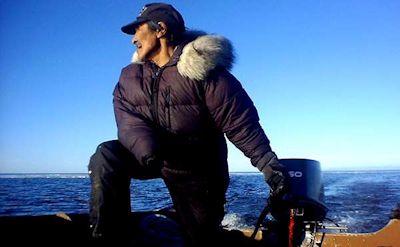 Deering Inupiat man on seal hunt
